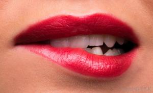 womans-lips-with-red-lipstick