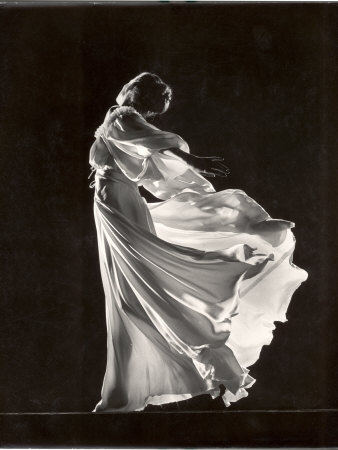 model-posing-in-billowing-light-colored-sheer-nightgown-and-peignoir