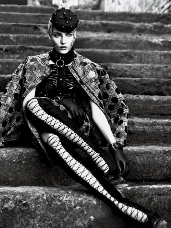 strict-Jacket, Skirt, and Hat Marc Jacobs. Top Louis Vuitton. Choker and Cuffs The Leather Man. Gloves Carolina Amato. Boots Alexander McQueen.