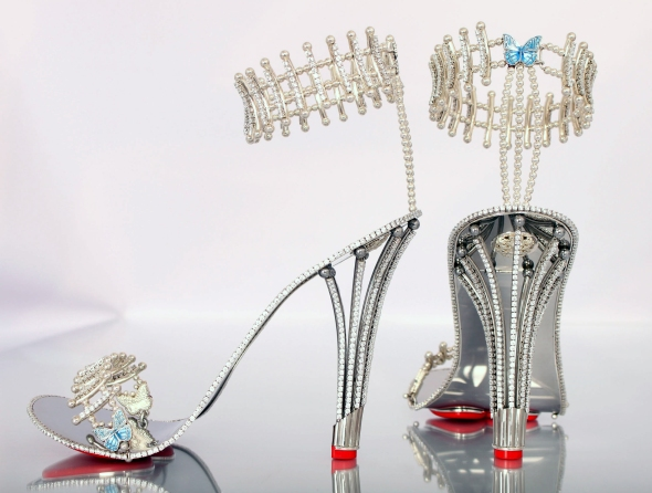 Beyonce has reportedly snapped up this pair of #200,000 GBP pounds [$312,000 USD approx] shoes from a British jeweller. The star is said to have bought the diamond-encrusted heels from Birmingham-based The House of Borgezie. She is expected to wear the Princess Constellation stilettos, which feature 1,290 precious stones in her next video as well as this #55,000 GBP pounds [$85,000 USD] gold basque belt. Chris Shellis, owner of House Of Borgezie, told a UK newspaper: