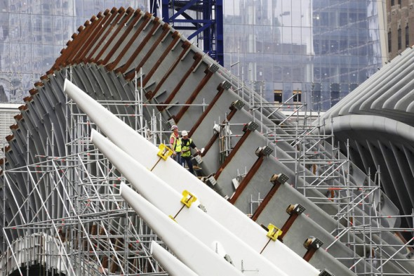 World-Trade-Center-Work continues on a new station at the redeveloped World Trade Center site in New York City. The project is at least $2 billion over budget. ASSOCIATED PRESS