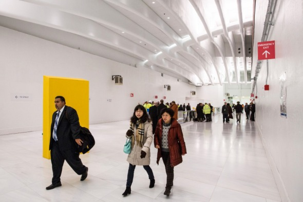 NEW YORK, NY - FEBRUARY 25: People walk through a hallway that gives access to a new platform for the New Jersey PATH Train at the World Trade Center, on February 25, 2014 in New York City. The platform will primarily service PATH trains from Hoboken, NJ, to New York, NY - it is expected to service 100,000 riders a day. (Photo by Andrew Burton/Getty Images)