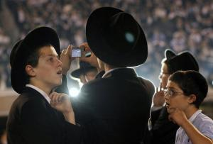 Orthodox Jewish boys stand together at MetLife stadium in East Rutherford, N.J,
