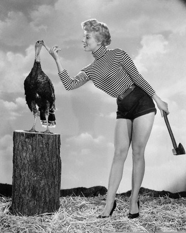 10 Nov 1954, Hollywood, Los Angeles, California, USA --- Film starlet Adelle August reminds one and all that Thanksgiving Day is Approaching rapidly. Although Adelle let her : off the spot, it's almost a sure bet that the Gobbler will find out about the celebration shortly. --- Image by © Bettmann/CORBIS