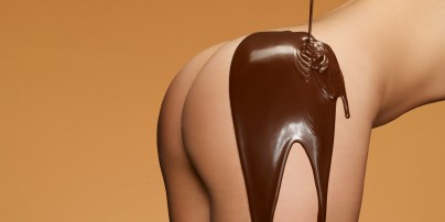 woman's bottom with chocolate dripping onto it