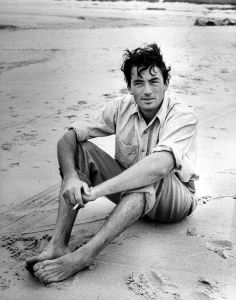 July 1946: Actor Gregory Peck sitting on the beach. (Photo by Eileen Darby/Time & Life Pictures/Getty Images)