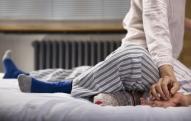 close up of couples legs wearing pyjamas