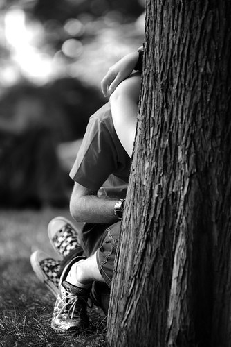 kiss against a tree