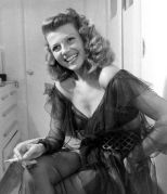 Rita Hayworth poses in a chiffon negligee at her home in Beverly Hills, 1945 negligee