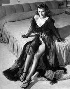 Rita Hayworth Posing Seductively in Sheer, Low Cut Chiffon Negligee