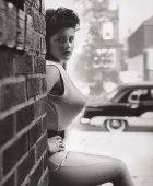 bullet-bra-fashion-vintage-brick wall