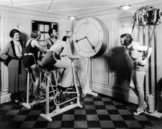 1930sNo Pain No Gain - Women exercise in a gym wearing high heels,