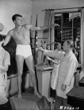 circa 1939: American leading man and future US President, Ronald Reagan modelling for a sculpture. (Photo via John Kobal Foundation/Getty Images)