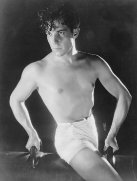 circa 1925: Mexican heartthrob Ramon Novarro (1899 - 1968) on a gymnasium horse. (Photo by General Photographic Agency/Getty Images)