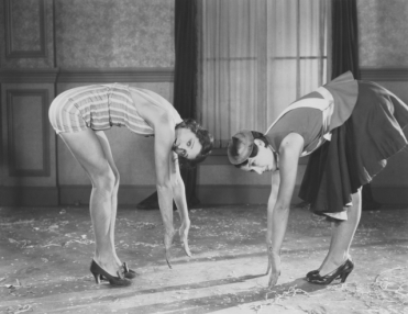 vintage workout stretching in heels