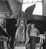 Jacob Epstein in his studio with his sculpture Lucifer