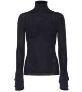 Blue Chloé Ruffle Cuff Ribbed Merino Wool Turtleneck Sweater.$895